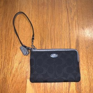 Black Coach wristlet with traditional C pattern